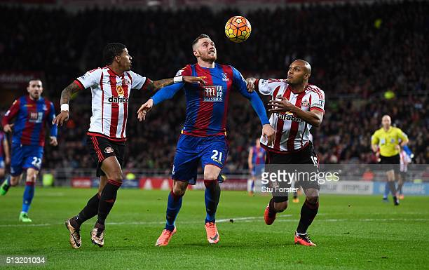 Connor Wickham of Crystal Palace competes for the ball against Patrick van Aanholt and Younes Kaboul of Sunderland during the Barclays Premier League...
