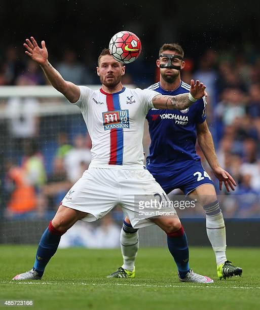 Connor Wickham of Crystal Palace holds off Gary Cahill of Chelsea during the Barclays Premier League match between Chelsea and Crystal Palace on...