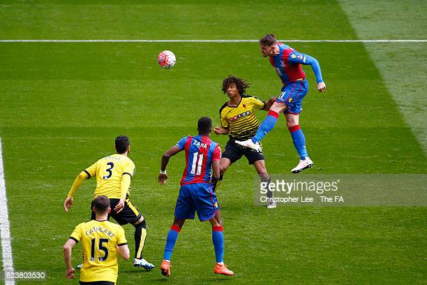 Connor Wickham of Crystal Palace rises above Nathan Ake of Watford to score his team's second goal during the The Emirates FA Cup Semi Final between...