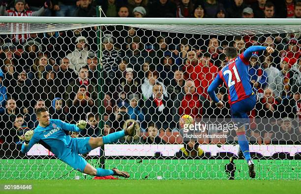 Connor Wickham of Crystal Palace scores his team's first goal from the penalty spot during the Barclays Premier League match between Stoke City and...