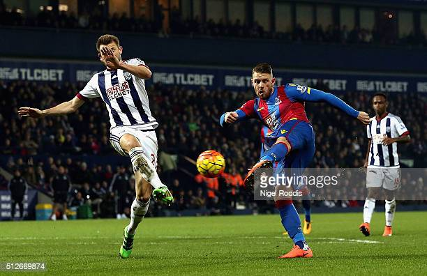 Connor Wickham of Crystal Palace shoots past Gareth McAuley of West Bromwich Albion to score their second goal during the Barclays Premier League...