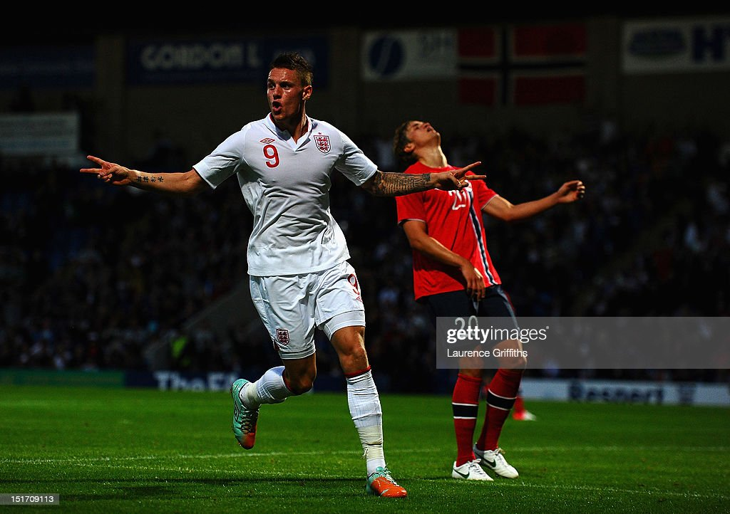 <a gi-track='captionPersonalityLinkClicked' href=/galleries/search?phrase=Connor+Wickham&family=editorial&specificpeople=6148574 ng-click='$event.stopPropagation()'>Connor Wickham</a> of England celebrates the opening goal during the UEFA Under-21 EURO 2013 Group 8 Qualifier between England and Norway at Proact Stadium on September 10, 2012 in Chesterfield, England.