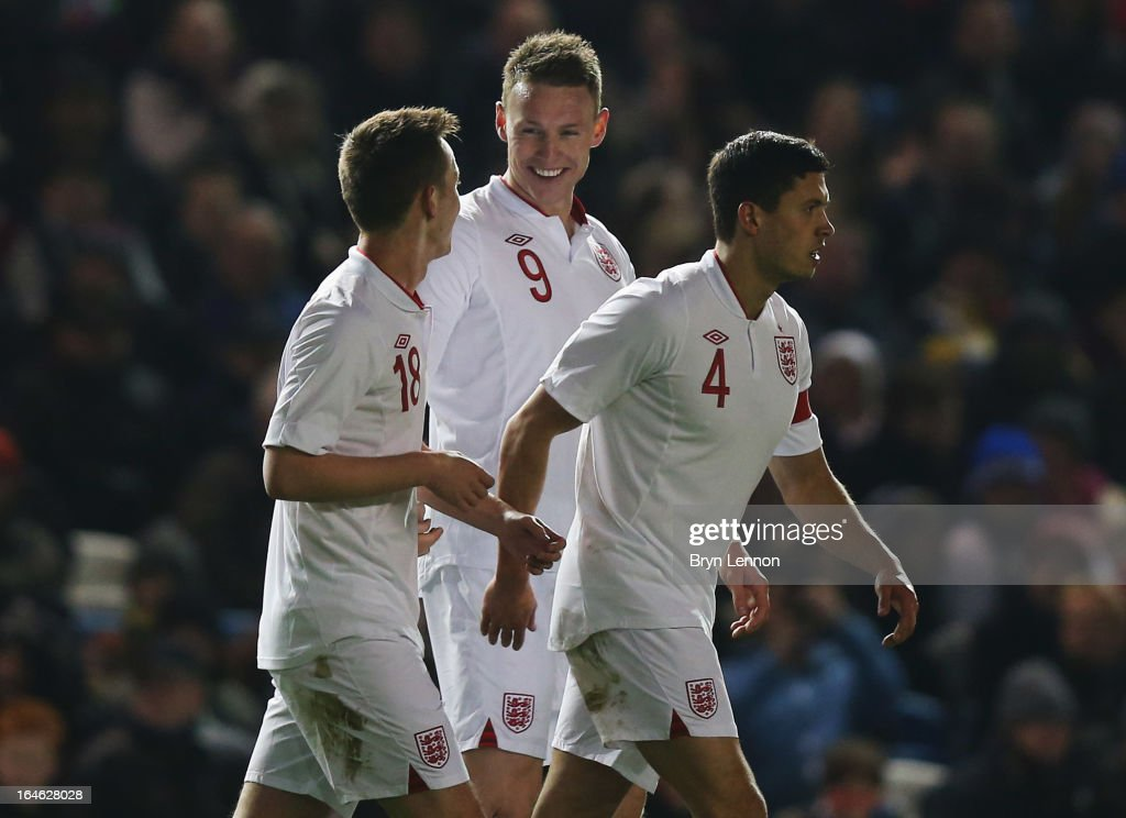 Connor Wickham of England (C) celebrates with Josh McEachran (L) and Jason Lowe (R) as he scores their fourth goal during the International friendly match between England U21 and Austria U21 at Amex Stadium on March 25, 2013 in Brighton, England.