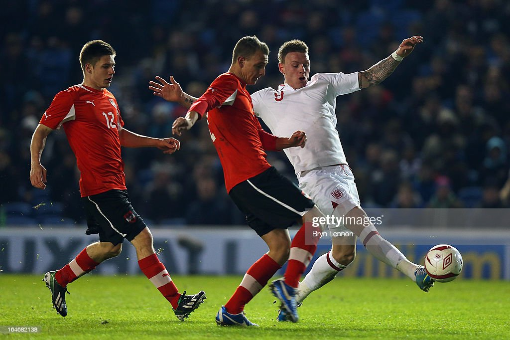 Connor Wickham of England takes on Patrick Farkas (L) and Florian Neuhold (C) of Austria during the International Friendly match between England U21 and Austria U21 at Amex Stadium on March 25, 2013 in Brighton, England.