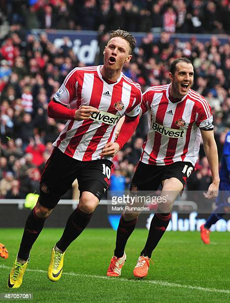 Connor Wickham of Sunderland celebrates scoring his second goal with John O'Shea of Sunderland during the Barclays Premier League match between...
