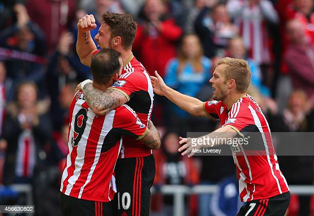 Connor Wickham of Sunderland celebrates scoring the opening goal with Steven Fletcher and Sebastian Larsson of Sunderland during the Barclays Premier...