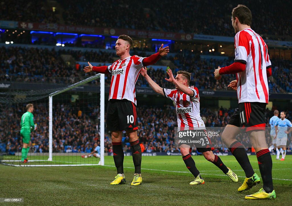 Connor Wickham of Sunderland celebrates scoring their second goal with Emanuele Giaccherini of Sunderland during the Barclays Premier League match between Manchester City and Sunderland at Etihad Stadium on April 16, 2014 in Manchester, England.