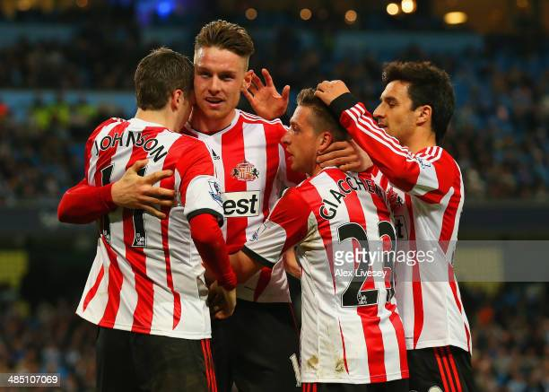 Connor Wickham of Sunderland celebrates scoring their second goal with Emanuele Giaccherin Adam Johnson and Ignacio Scocco of Sunderland during the...
