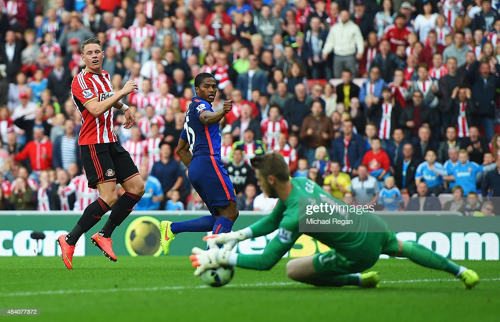 Connor Wickham of Sunderland has his shot saved by David De Gea of Manchester United during the Barclays Premier League match between Sunderland and Manchester United at Stadium of Light on August 24, 2014 in Sunderland, England.