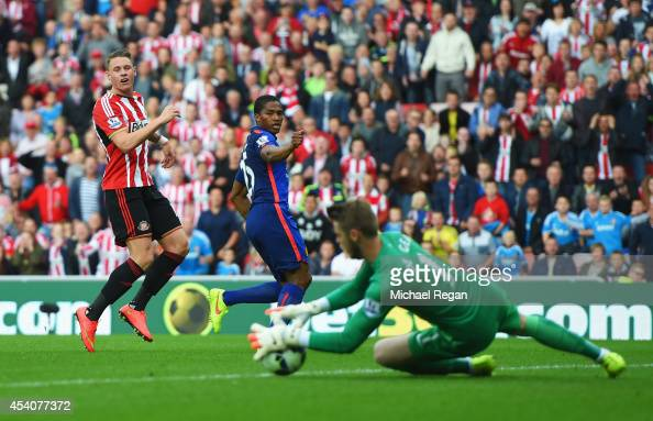 Connor Wickham of Sunderland has his shot saved by David De Gea of Manchester United during the Barclays Premier League match between Sunderland and...