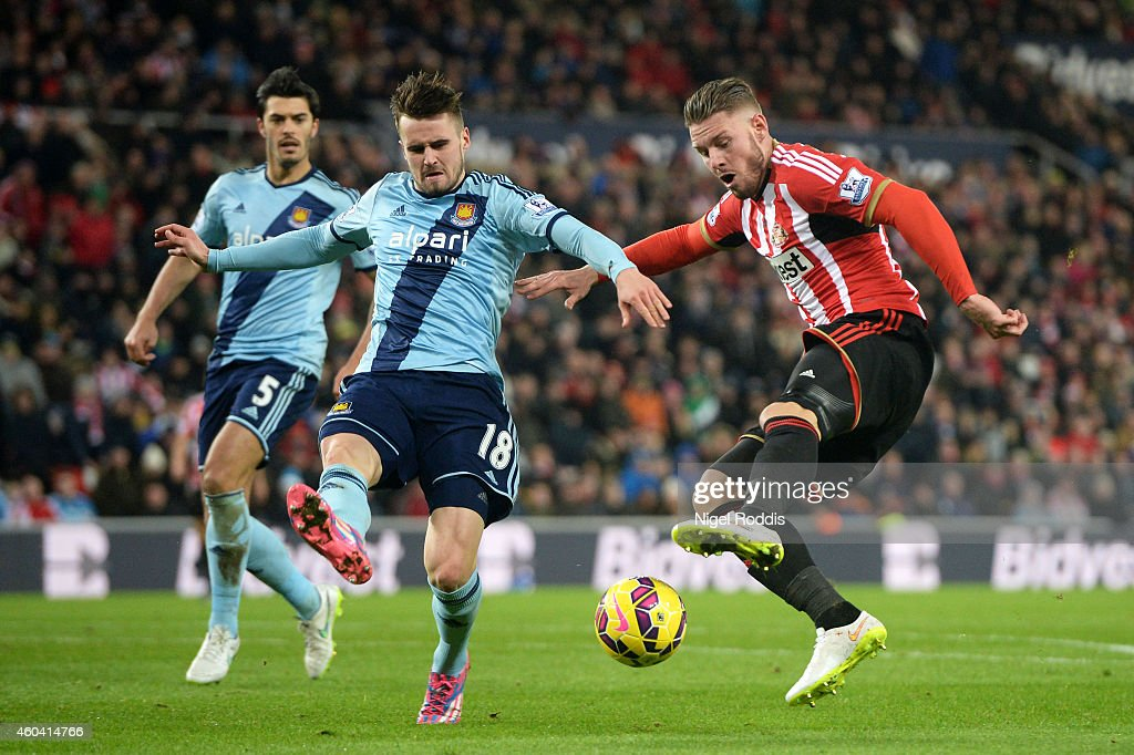 Connor Wickham of Sunderland is closed down by Carl Jenkinson of West Ham during the Barclays Premier League match between Sunderland and West Ham United at Stadium of Light on December 13, 2014 in Sunderland, England.