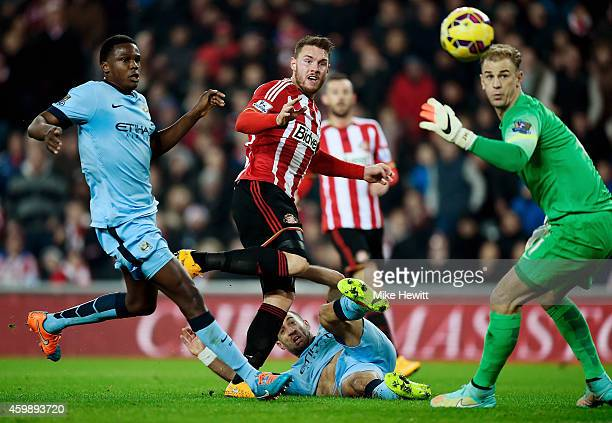Connor Wickham of Sunderland scores the opening goal during the Barclays Premier League match between Sunderland and Manchester City at The Stadium...