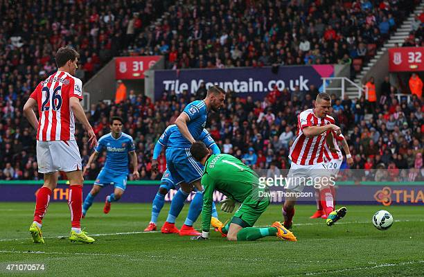 Connor Wickham of Sunderland scores the opening goal past Asmir Begovic of Stoke City during the Barclays Premier League match between Stoke City and...
