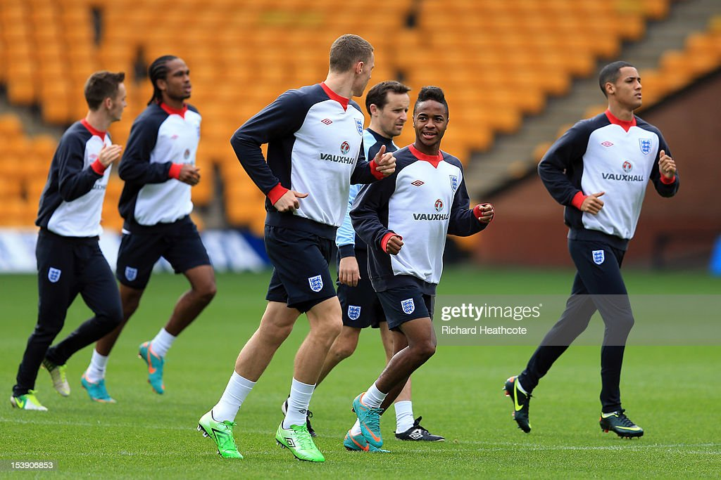 Connor Wickham talks with Raheem Sterling during the England U21 training session at Carrow Road on October 11, 2012 in Norwich, England. England's U21 team will play Serbia U21 in the first leg of the U21 European Championship play-off's at Carrow Road tomorrow night.