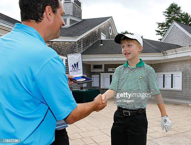 Connor Willett receives his medal after winning the Drive Chip and Put Regional Championship Boys 10 11 Division at Pinehills Golf Club on August 12...