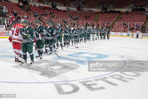 Connor Wood of the Michigan State Spartans and Tanner Laczynski of the Ohio State Buckeyes shake hands at center ice after game one of the Big Ten...