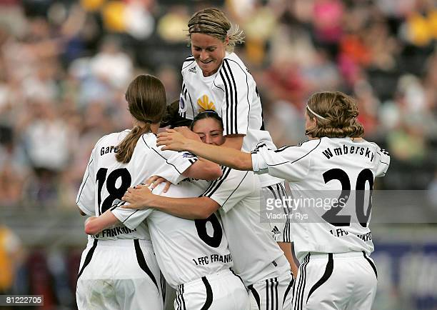 Conny Pohlers of Frankfurt is celebrated by her team mates after scoring the 20 goal during the second leg UEFA Women's Cup final match between FFC...