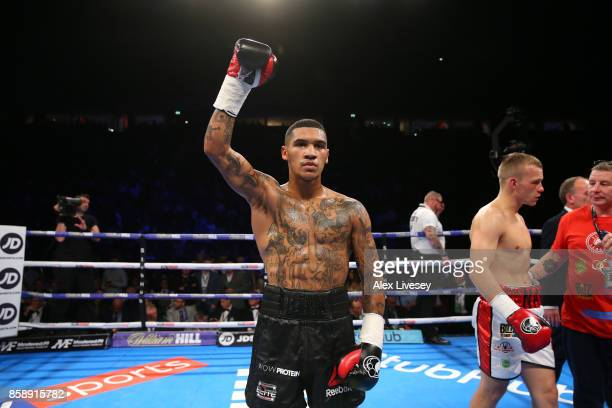 Conor Benn celebrates victory over Nathan Clarke during the Welterweight Championship fight at Manchester Arena on October 7 2017 in Manchester...