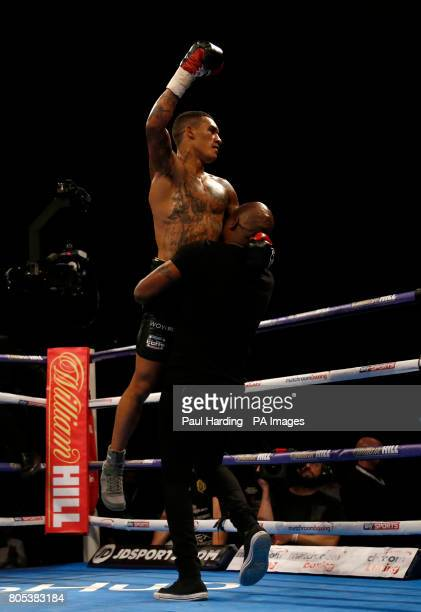 Conor Benn is congratulated by his father Nigel after defeating Mike Cole in the Welterweight contest at the O2 Arena London