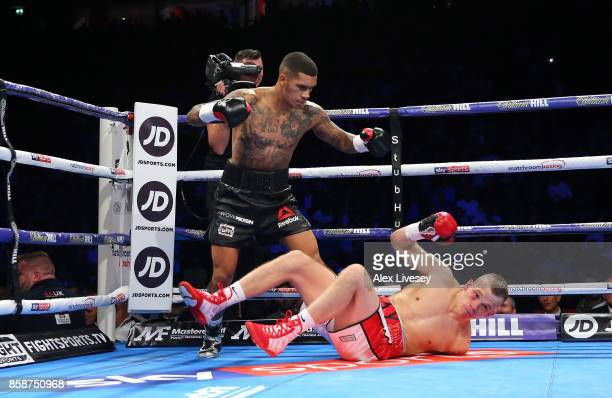 Conor Benn knocks down Nathan Clarke for the first time during the Welterweight Championship fight at Manchester Arena on October 7 2017 in...