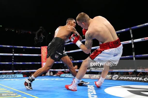 Conor Benn knocks down Nathan Clarke for the second time during the Welterweight Championship fight at Manchester Arena on October 7 2017 in...