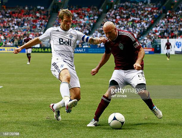 Conor Casey of the Colorado Rapids and Jay DeMerit of the Vancouver Whitecaps FC battle for the ball during their MLS game September 23 2012 at BC...