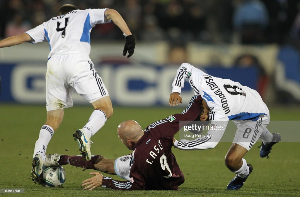 Conor Casey of the Colorado Rapids controls the ball between Sam Cronin and Chris Wondolowski of the San Jose Earthquakes during the MLS Eastern...