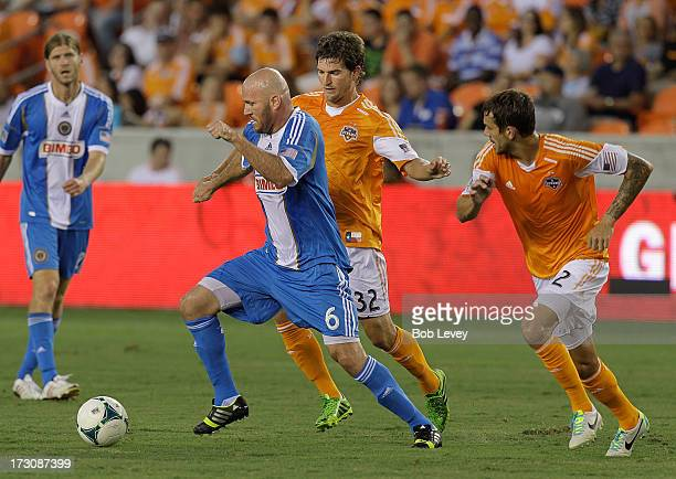 Conor Casey of the Philadelphia Union brings the ball up the field as he is covered by Bobby Boswell of the Houston Dynamo in the first half at BBVA...