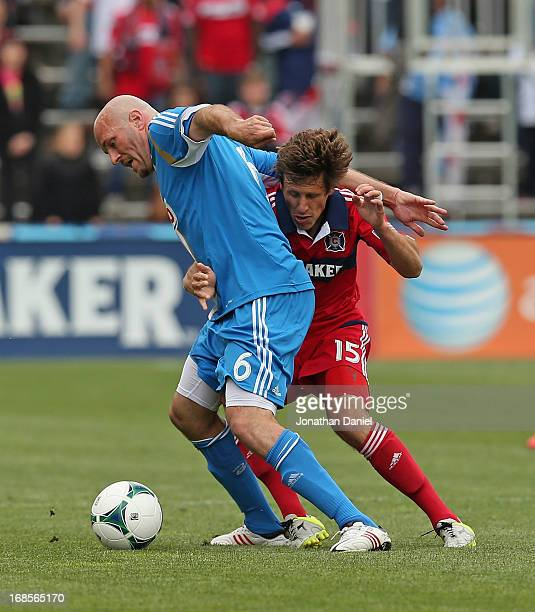 Conor Casey of the Philadelphia Union holds off Wells Thompson of the Chicago Fire during an MLS match at Toyota Park on May 11 2013 in Bridgeview...