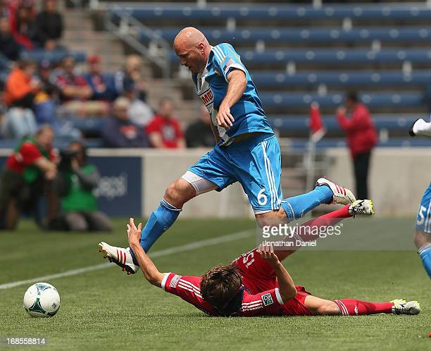 Conor Casey of the Philadelphia Union leaps over Wells Thompson of the Chicago Fire during an MLS match at Toyota Park on May 11 2013 in Bridgeview...
