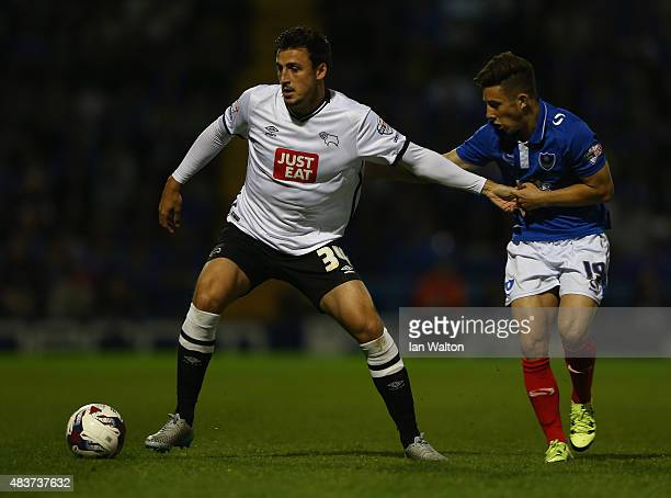 Conor Chaplin of Portsmouth tries to tackle George Thorne of Derby County during the Capital One Cup First Round match between Portsmouth v Derby...