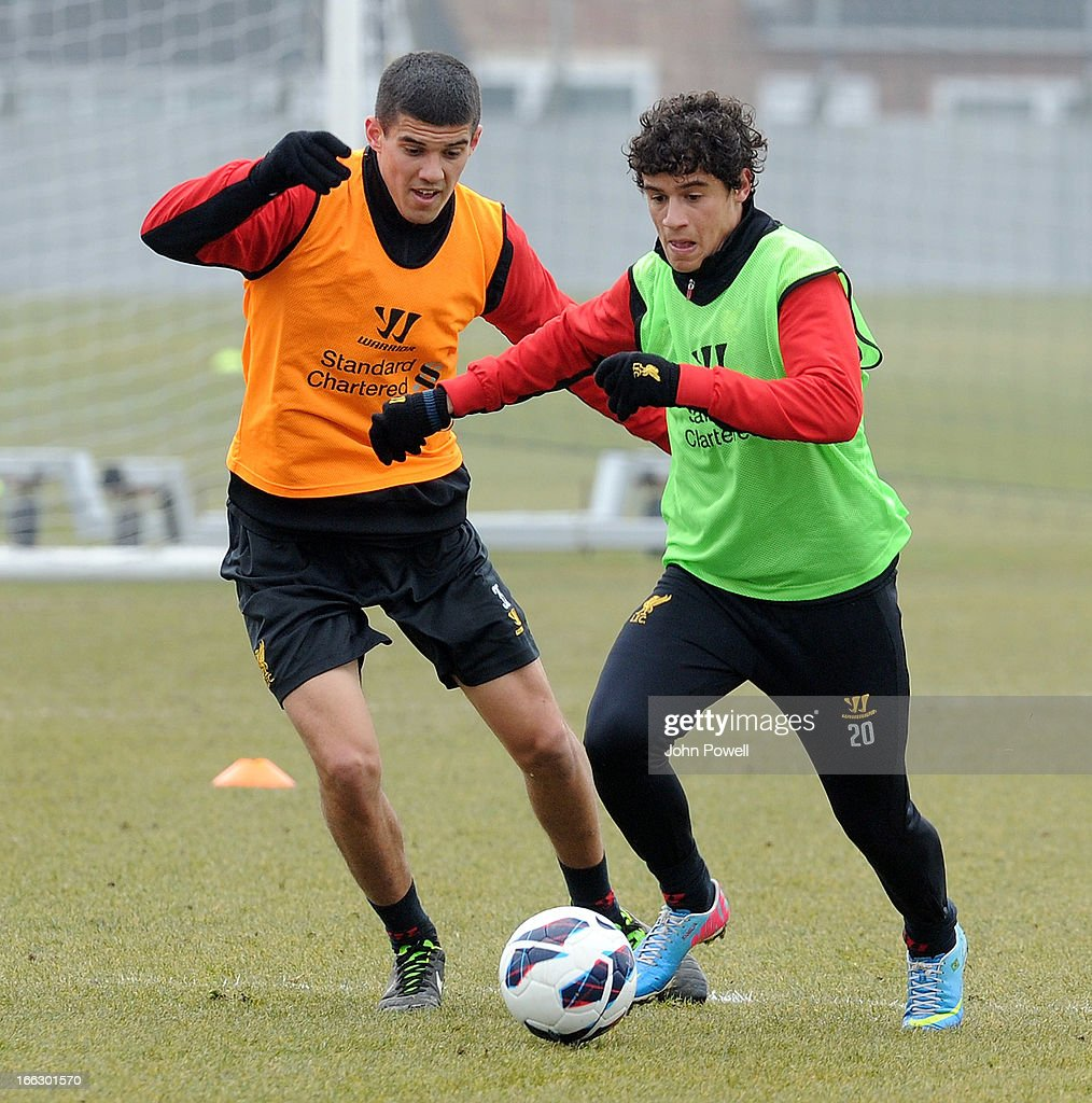 Conor Coady and Phillipe Coutinho of Liverpool in action during a training session at Melwood Training Ground on April 11, 2013 in Liverpool, England.