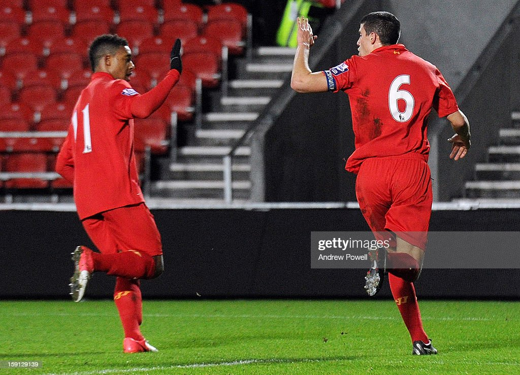 Conor Coady (R) of Liverpool celebrates after scoring a penalty during the NextGen Series Group 5 match between Liverpool U19 and Inter Milan U19 at Langtree Park on January 8, 2013 in St Helens, England.