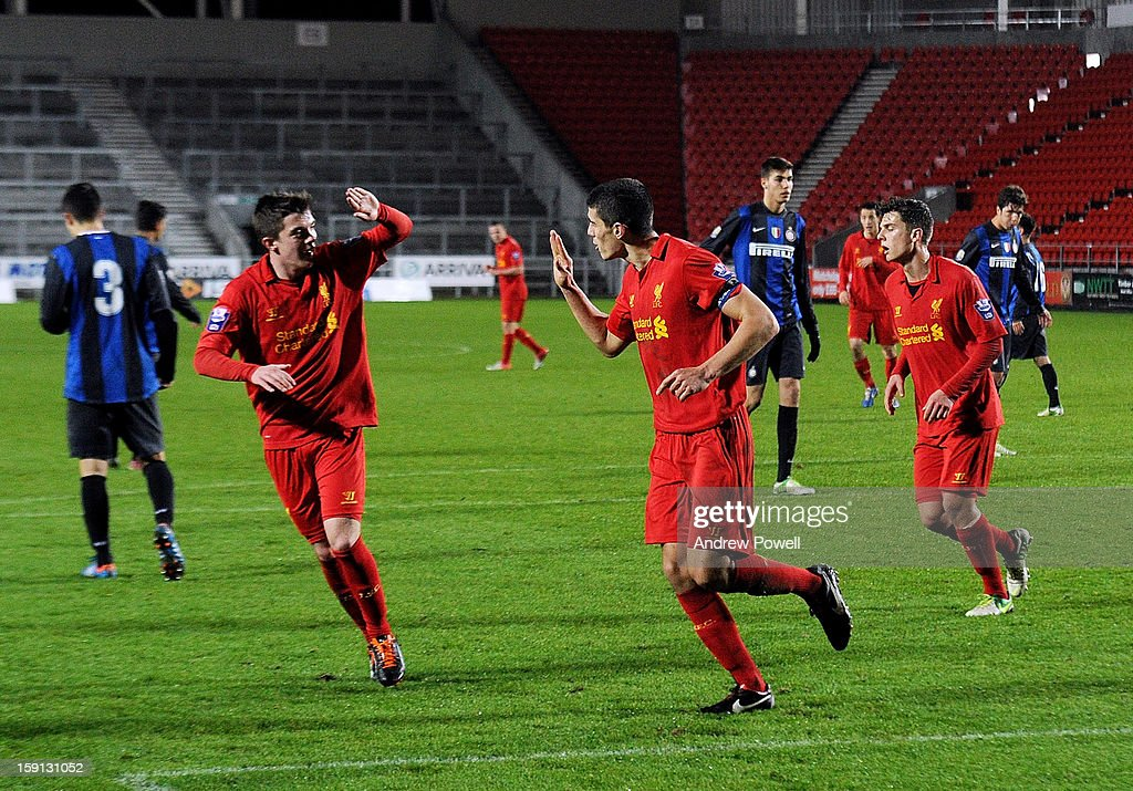 Conor Coady of Liverpool (C) celebrates after scoring the second penalty of the game to make the score 4-1 during the NextGen Series Group 5 match between Liverpool U19 and Inter Milan U19 at Langtree Park on January 8, 2013 in St Helens, England.