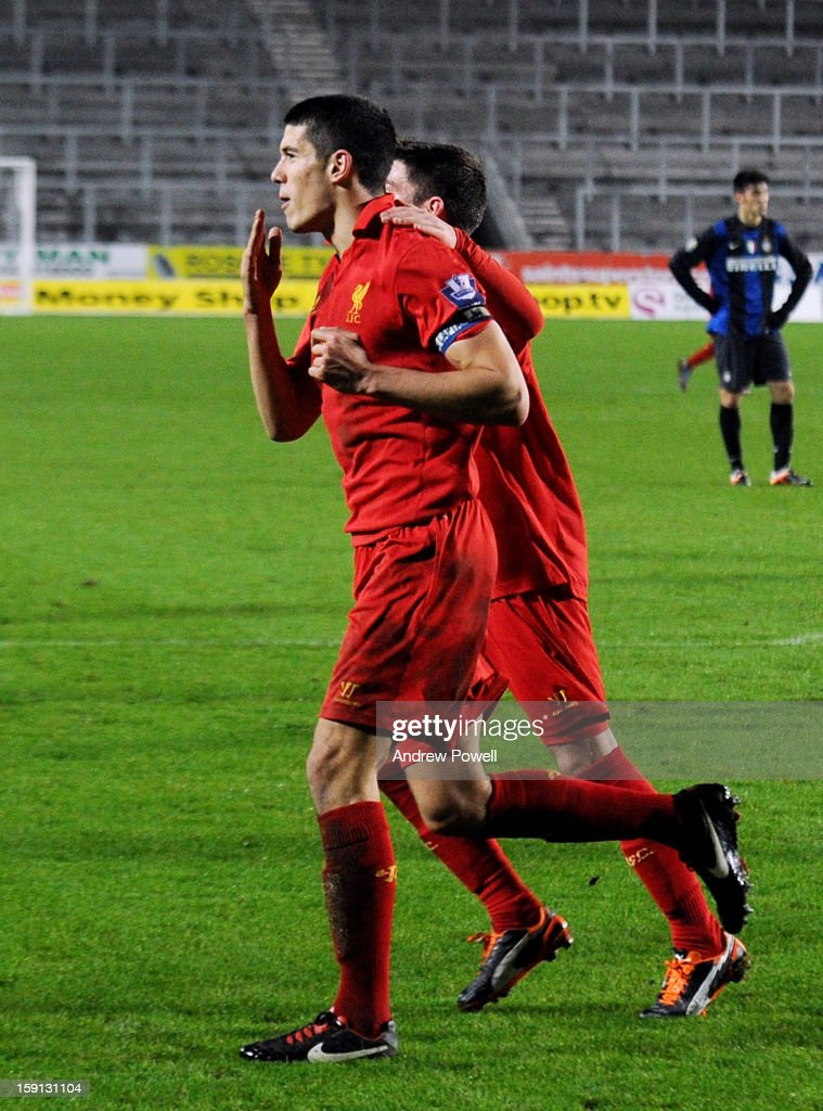 Conor Coady (L) of Liverpool celebrates after scoring the second penalty of the game to make the score 4-1 during the NextGen Series Group 5 match between Liverpool U19 and Inter Milan U19 at Langtree Park on January 8, 2013 in St Helens, England.