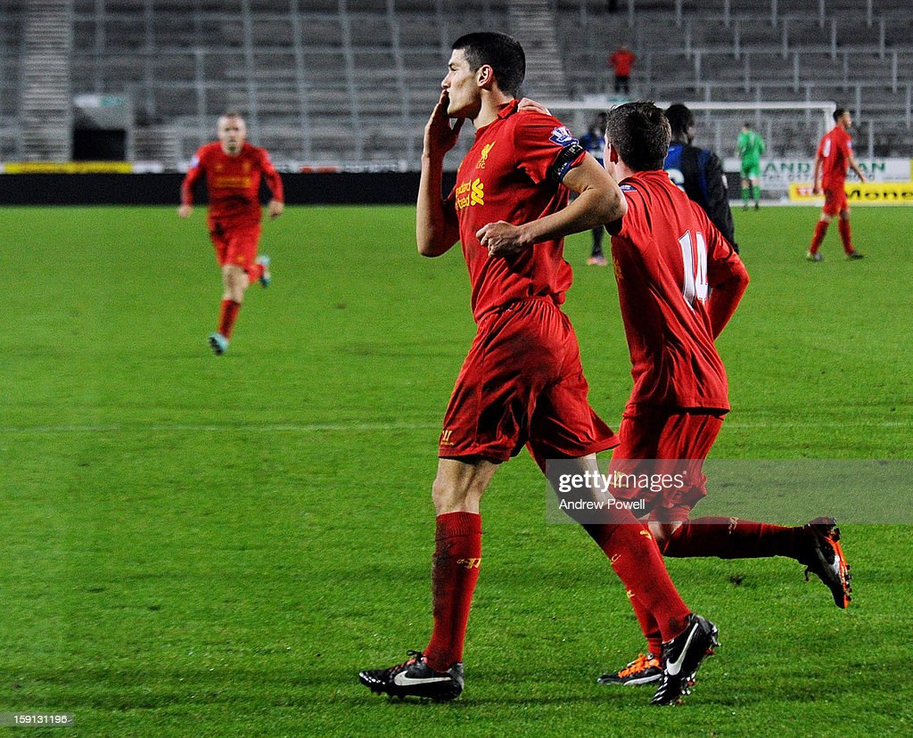 Conor Coady (C) of Liverpool celebrates after scoring the second penalty of the game to make the score 4-1 during the NextGen Series Group 5 match between Liverpool U19 and Inter Milan U19 at Langtree Park on January 8, 2013 in St Helens, England.