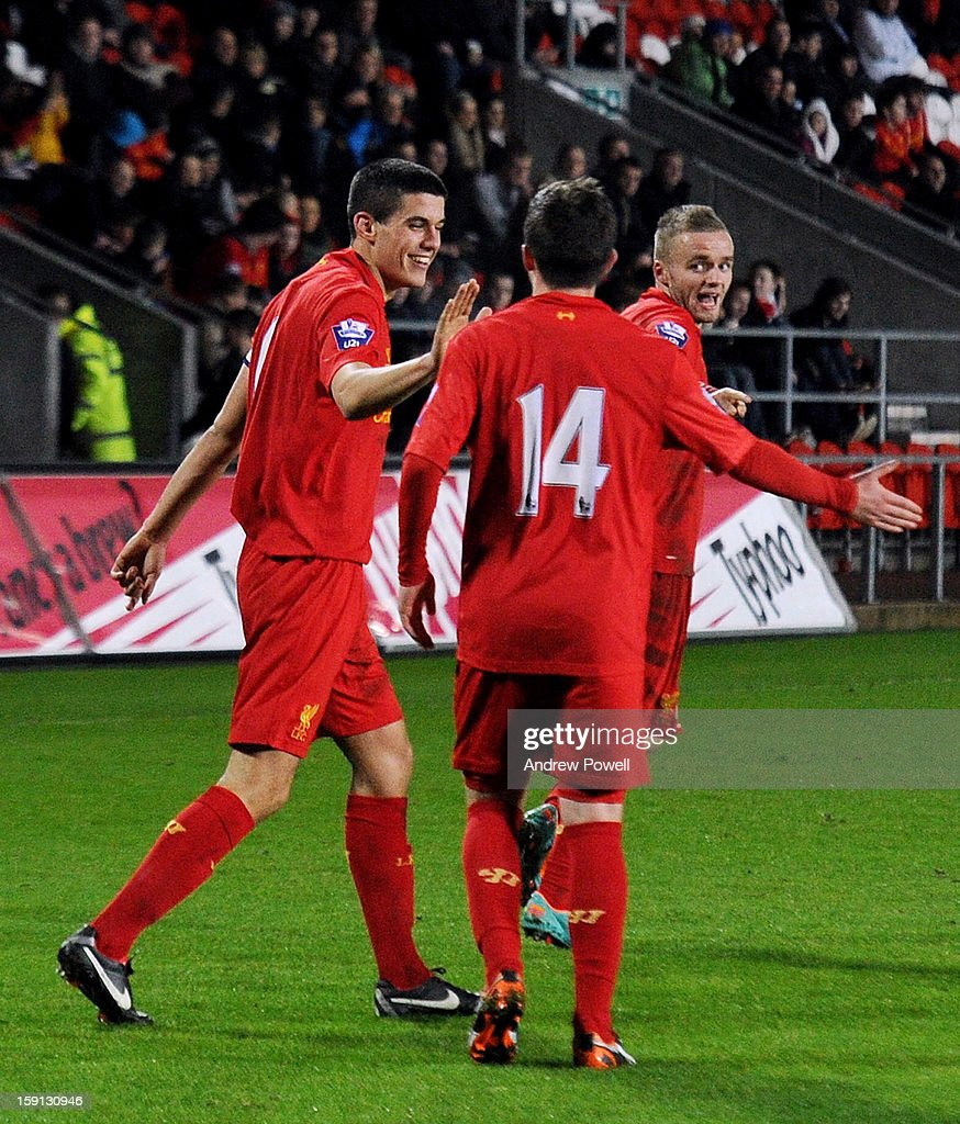 Conor Coady (L) of Liverpool celebrates with team-mates after scoring the second penalty of the game to make the score 4-1 during the NextGen Series Group 5 match between Liverpool U19 and Inter Milan U19 at Langtree Park on January 8, 2013 in St Helens, England.