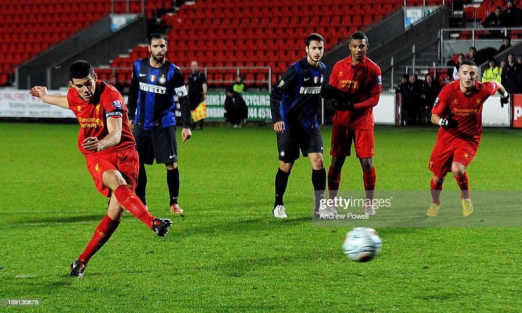 Conor Coady of Liverpool scores the second penalty of the game to make the score 4-1 during the NextGen Series Group 5 match between Liverpool U19 and Inter Milan U19 at Langtree Park on January 8, 2013 in St Helens, England.
