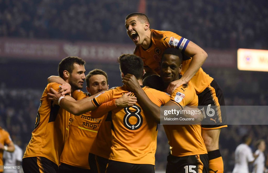 Conor Coady of Wolverhampton Wanderers (top) joins the celebration following the first goal of the game during the Sky Bet Championship match between Wolverhampton Wanderers and Fulham at Molineux on November 3, 2017 in Wolverhampton, England.