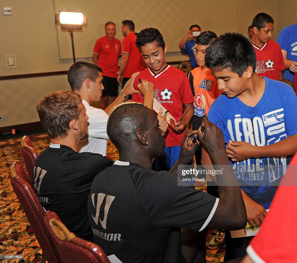 Conor Cody of Liverpool, Lucas of Liverpool and Mamadou Sakho of Liverpool have a Q and A session with Camden Youth Soccer Club when they visit the Liverpool team gotel on July 28, 2014 in Princeton, New Jersey.
