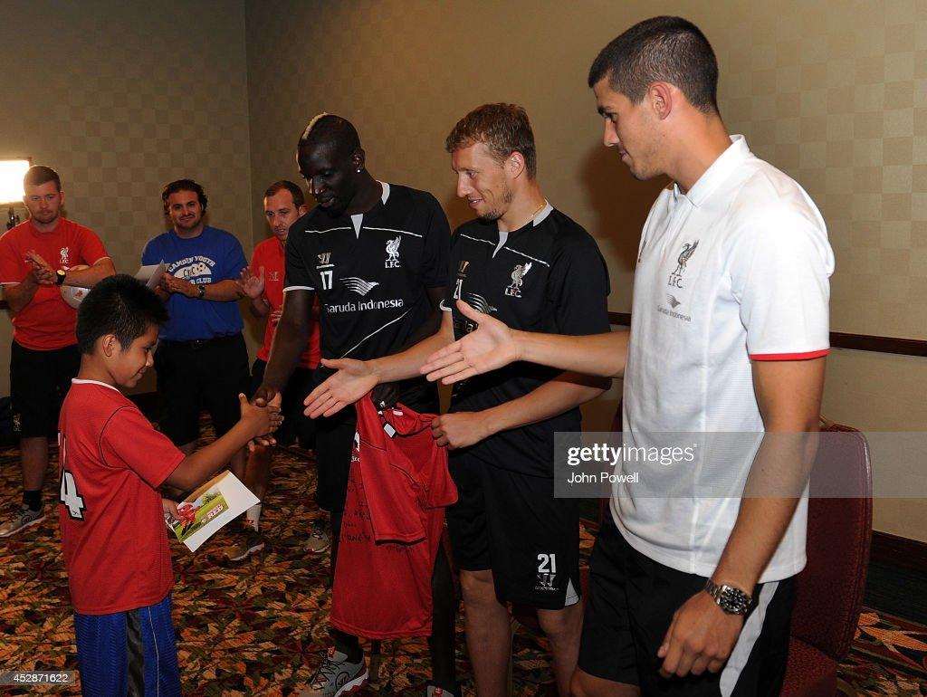 Conor Cody of Liverpool, Lucas of Liverpool and <a gi-track='captionPersonalityLinkClicked' href=/galleries/search?phrase=Mamadou+Sakho&family=editorial&specificpeople=4154099 ng-click='$event.stopPropagation()'>Mamadou Sakho</a> of Liverpool have a Q and A session with Camden Youth Soccer Club when they visit the Liverpool team gotel on July 28, 2014 in Princeton, New Jersey.