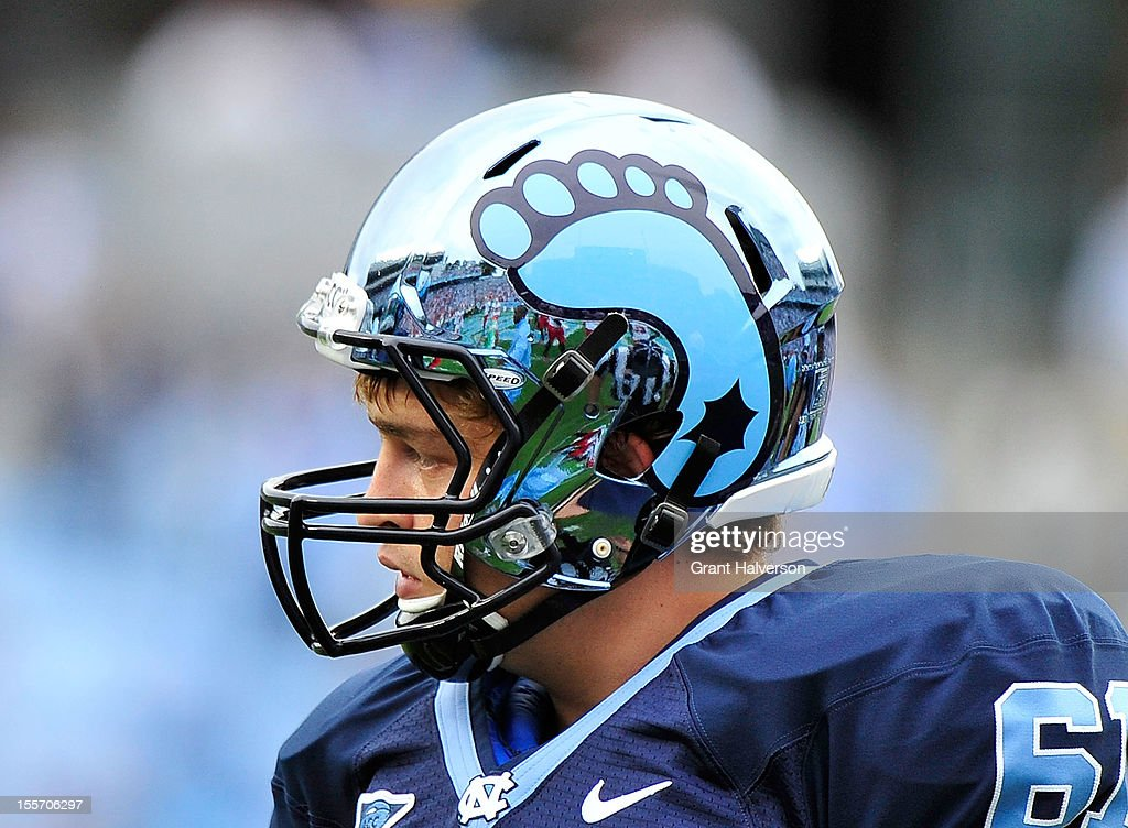 Conor Fry #61 of the North Carolina Tar Heels wears the team's new chrome helmet against the North Carolina State Wolfpack during play at Kenan Stadium on October 27, 2012 in Chapel Hill, North Carolina. North Carolina won 43-35.
