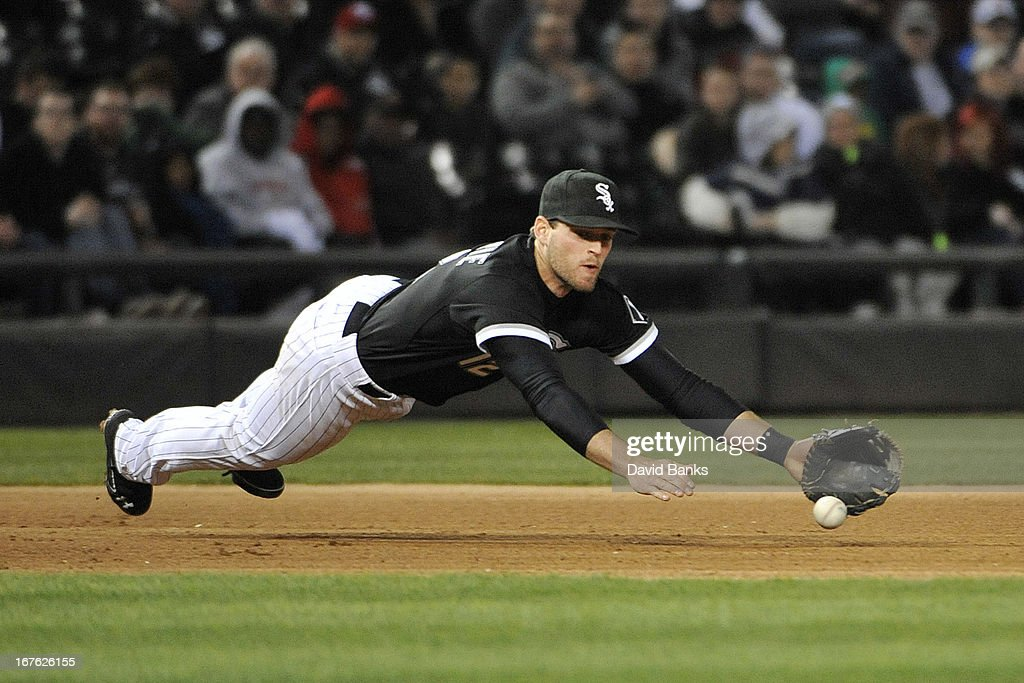 Conor Gillaspie #12 of the Chicago White Sox dives for a hit off the bat of <a gi-track='captionPersonalityLinkClicked' href=/galleries/search?phrase=Evan+Longoria&family=editorial&specificpeople=2349329 ng-click='$event.stopPropagation()'>Evan Longoria</a> #3 of the Tampa Bay Rays during the eighth inning on April 26, 2013 at U.S. Cellular Field in Chicago, Illinois.