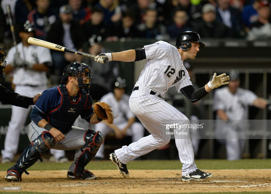 <a gi-track='captionPersonalityLinkClicked' href=/galleries/search?phrase=Conor+Gillaspie&family=editorial&specificpeople=5115369 ng-click='$event.stopPropagation()'>Conor Gillaspie</a> #12 of the Chicago White Sox follows through on an RBI single scoring Adam Eaton #1 during the fifth inning against the Cleveland Indians at U.S. Cellular Field on April 11, 2014 in Chicago, Illinois.