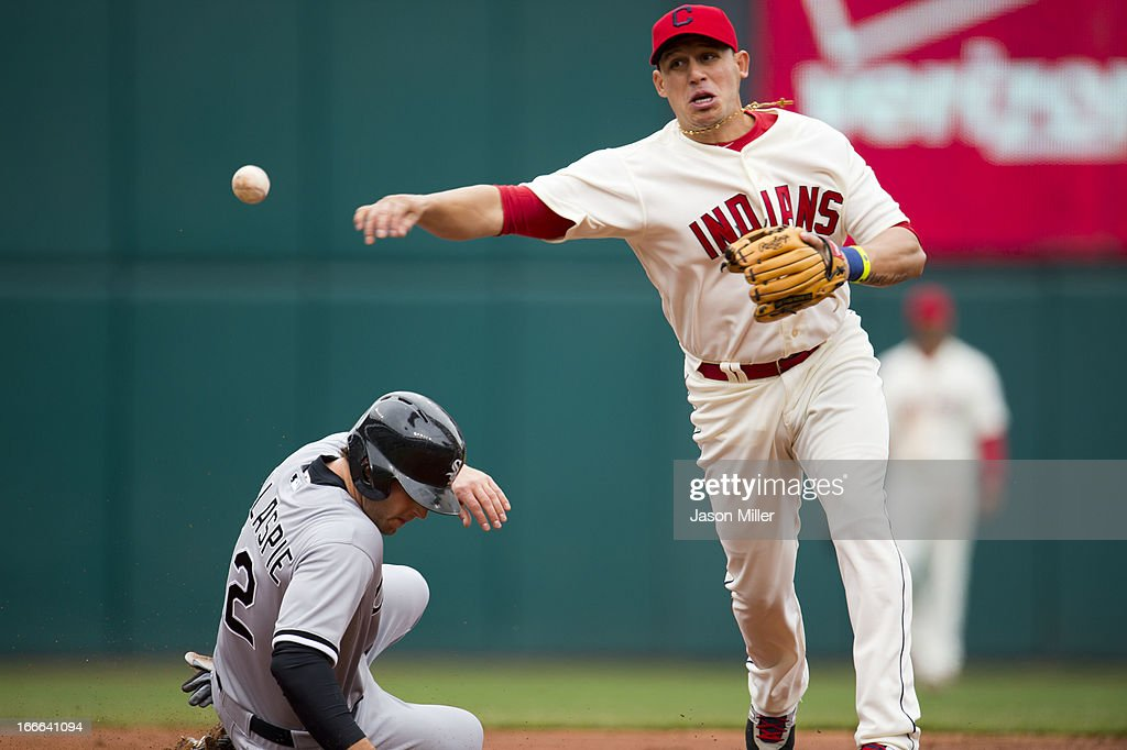 Conor Gillaspie #12 of the Chicago White Sox is out at second as shortstop <a gi-track='captionPersonalityLinkClicked' href=/galleries/search?phrase=Asdrubal+Cabrera&family=editorial&specificpeople=834042 ng-click='$event.stopPropagation()'>Asdrubal Cabrera</a> #13 of the Cleveland Indians throws to first during the third inning at Progressive Field on April 14, 2013 in Cleveland, Ohio. The White Sox defeated the Indians 3-1.
