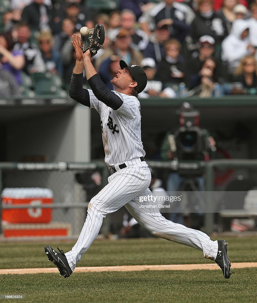 Conor Gillaspie #12 of the Chicago White Sox makes a catch against the Seattle Mariners at U.S. Cellular Field on April 6, 2013 in Chicago, Illinois. The White Sox defeated the Mariners 4-3.