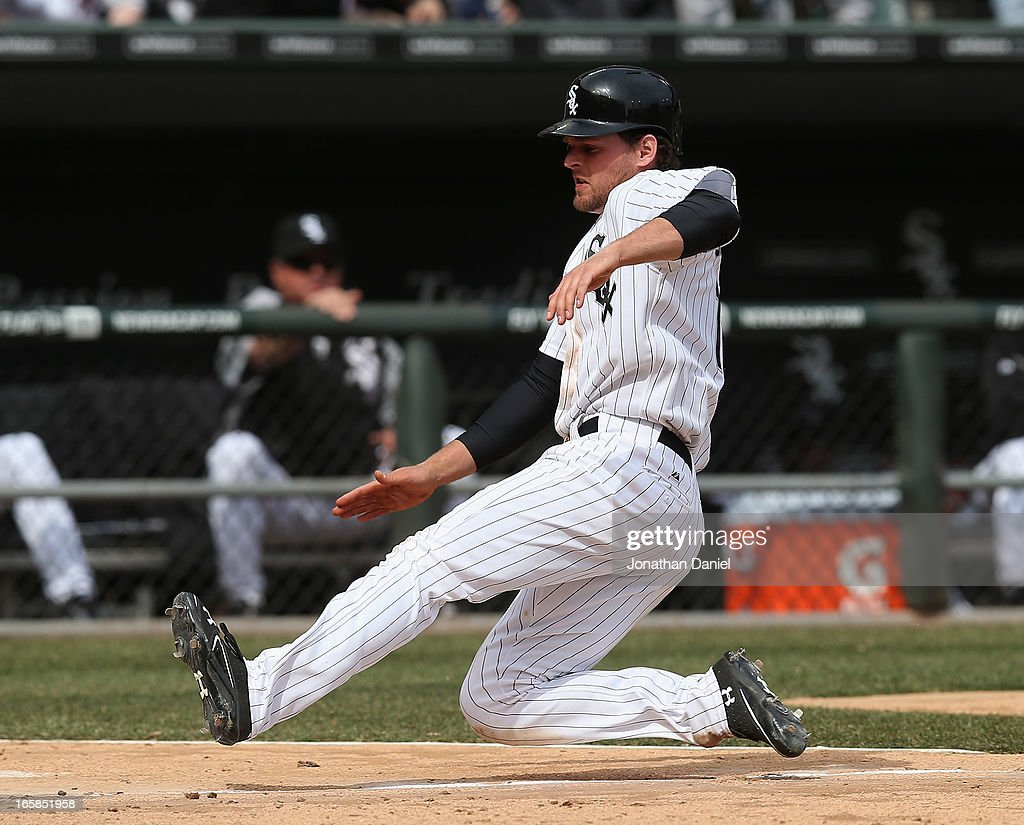 Conor Gillaspie #12 of the Chicago White Sox slides in to socre a run in the 7th inning against the Seattle Mariners at U.S. Cellular Field on April 6, 2013 in Chicago, Illinois. The White Sox defeated the Mariners 4-3.