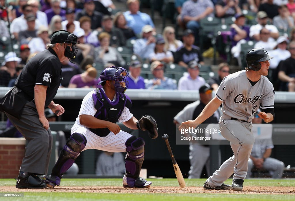 Conor Gillaspie of the Chicago White Sox takes an at bat as catcher Wilin Rosario of the Colorado Rockies backs up the plate and umpire Joe West...