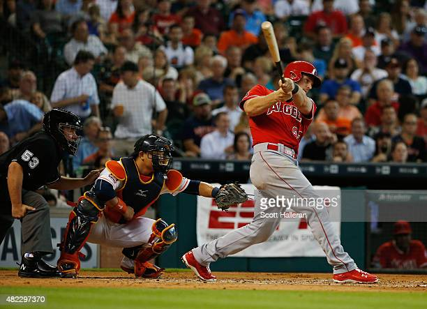 Conor Gillaspie of the Los Angeles Angels of Anaheim connects on an RBI triple in the second inning during their game against the Houston Astros at...