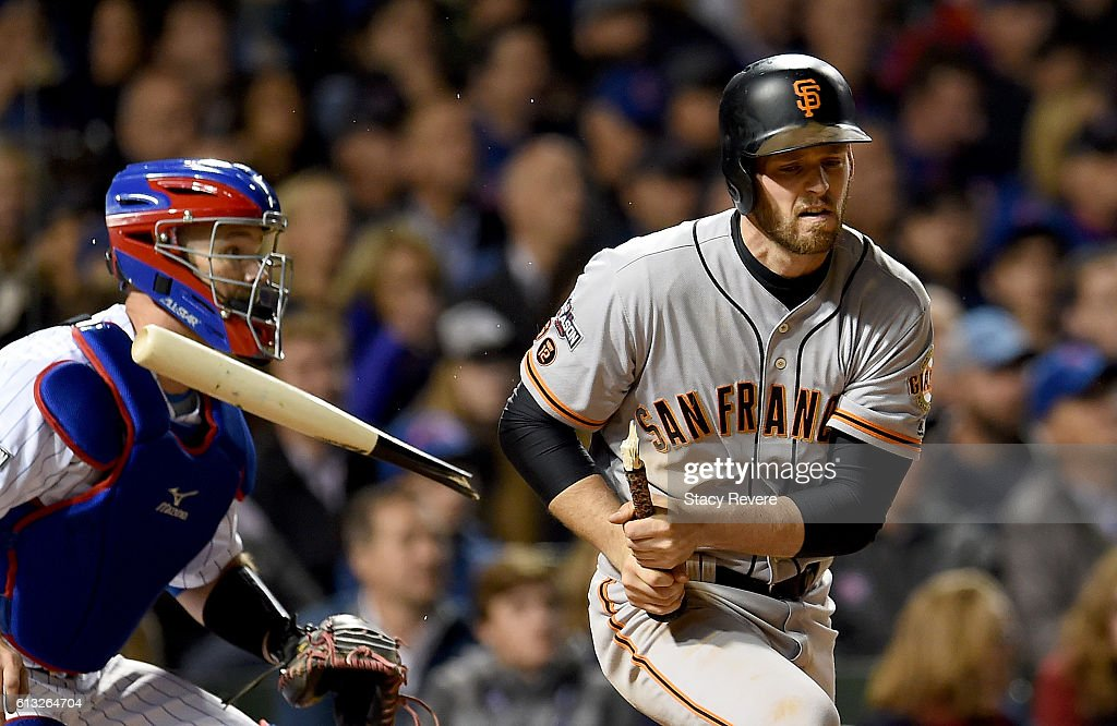 Conor Gillaspie #21 of the San Francisco Giants breaks his bat in the fifth inning against the Chicago Cubs at Wrigley Field on October 7, 2016 in Chicago, Illinois.
